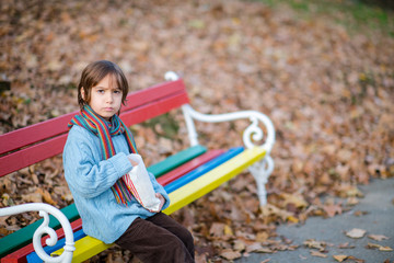 cute little boy in park eating popcorn