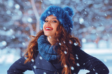 Portrait of a beautiful young woman on a winter day