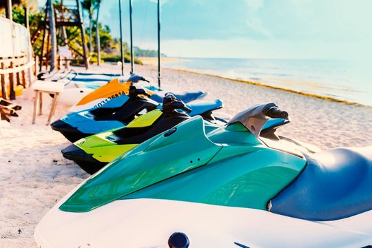 Row of Jet Skis to hire on a beautiful white Caribbean sandy beach on the Riviera Maya, Mexico beside the ocean