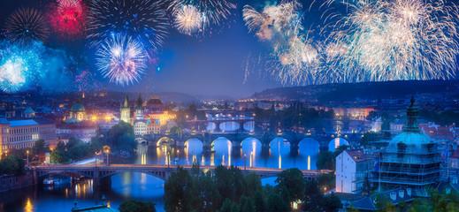 Beautiful fireworks above Prague with bridges on Vltava river