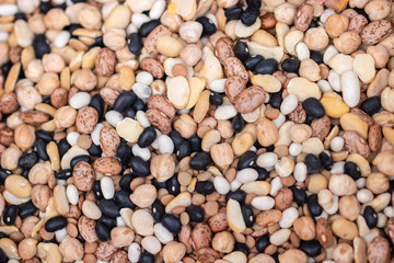 Closeup of different types of beans background. Bean texture