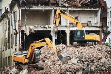 excavator crasher machine at demolition on construction site