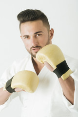 Sport gloves. Handsome sportsman with a beard and wearing gloves. Photo portrait of an athlete. Clothes for hobby sports