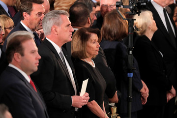 House Minority leader Kevin McCarthy and U.S. Representative Nancy Pelosi (D-CA) attend ceremonies for the late former U.S. President George H.W. Bush inside the U.S. Capitol rotunda in Washington