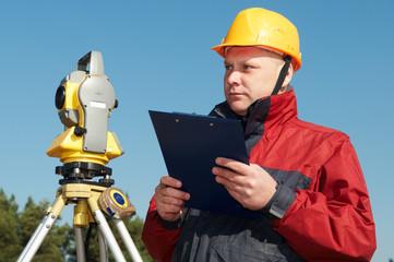 surveyor worker with theodolite