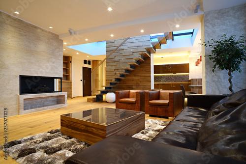 Commodius living room in duplex apartment interior\