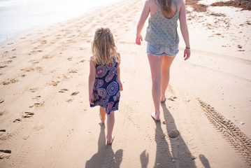 sisters walk together on the beach
