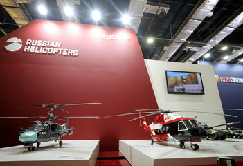 Models of helicopters are displayed on the Russian stand during on the first day of Egypt Defense Expo, showcasing military systems and hardware in Cairo