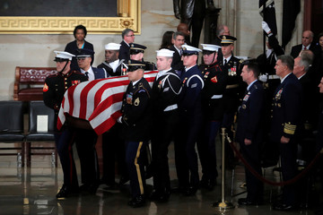 Military Honor Guard carries casket during ceremonies for the late former U.S. President George H.W. Bush inside the U.S. Capitol rotunda in Washington