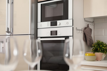 Modern combination oven with microwave in light kitchen