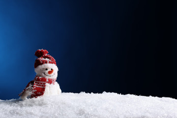 Decorative snowman on color background, space for text. Winter weather