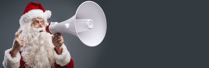 Santa Claus shouting with a megaphone