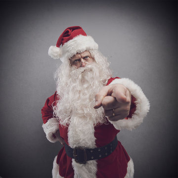 Disappointed Santa pointing his finger at you