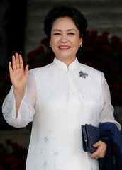 Peng Liyuan, wife of China's President Xi Jinping, poses for a picture after arriving to the Presidential Palace as part of Xi's first state visit to Panama, in Panama City