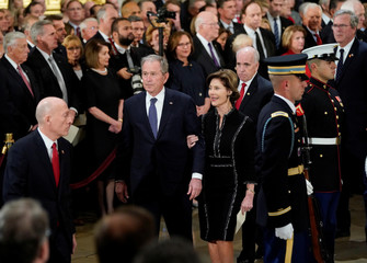 Former President George W. Bush, former first lady Laura Bush walk past leaders of Congress after attending ceremonies for former President George H.W. Bush in the Capitol Rotunda