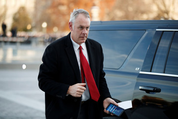 US Secretary of the Interior Ryan Zinke arrives at the US Capitol prior to the service for former President George H. W. Bush in Washington, DC, USA
