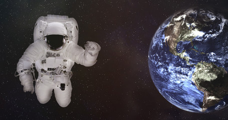 Astronaut in outer space with Earth planet of solar system with reflection in helmet. Science fiction wallpaper. Elements of this image were furnished by NASA.