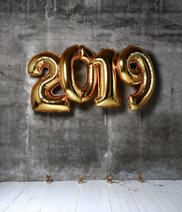2019 Christmas inflatable gold numbers balloons on the loft wall background new year