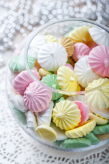 Colorful meringue cookies on napkin, natural light selective focus