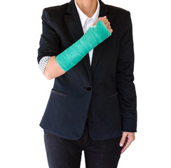 Injured businesswoman with broken hand and green cast  standing on white background