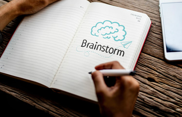 Text Brainstrom on a notebook