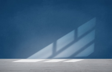 Blue wall in an empty room with concrete floor
