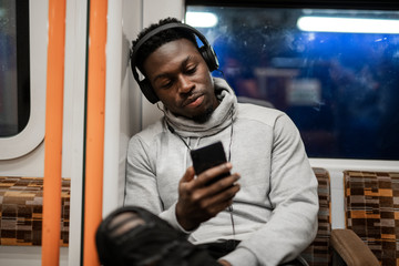 Bored man texting while on the train