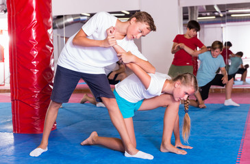 Kids exercising self-defense movements