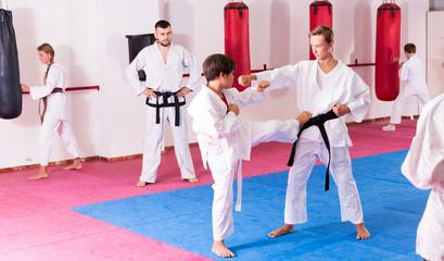 Children practicing karate in pair
