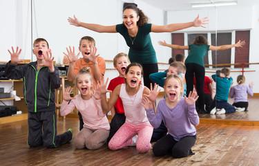 Happy children  in dance studio having fun