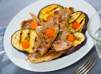Mutton chops served with grilled vegetables
