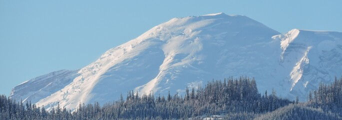 Mt. Rainier Peaks Over a Foothill on it's North 2