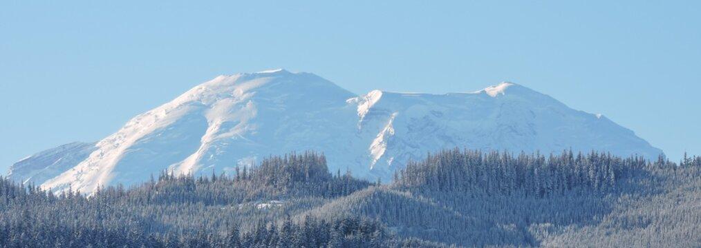 Mt. Rainier Peaks Over a Foothill on it's North 3