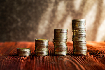 Coins Tower on the Wood Table, Concept picture of Financial Investment Plan Growth or Money Saving