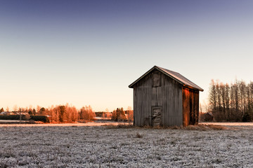 Small Barn House In The Winter Sunrise
