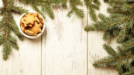 Delicious ginger biscuits. Fir branch. New Year. Light background