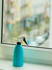 Spray bottle next to window