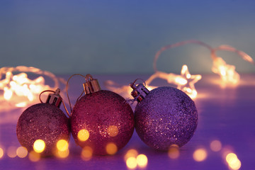 Image of christmas festive tree gold, purple and violet balls decoration.