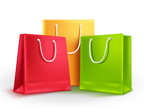 Paper bags group vector illustration. Empty shopping bags with assorted colors isolated in white for fashion and store market design elements.