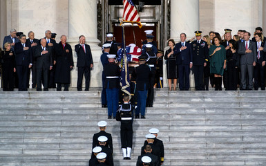 The casket carrying former president George Herbert Walker Bush is carried up the steps of the US Capitol in Washington, Monday, December 3, 2018.