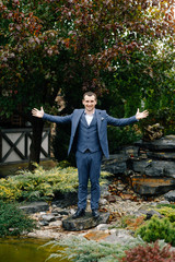 Portrait of a stylish groom's friend in a blue suit