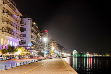 Thessaloniki, Greece night view of The White Tower and surrounding waterfront.The city's landmark seen from Christmas 2018 illuminated old waterfront area.