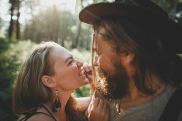 Sensual hipster couple in boho clothes in nature. Summer photo