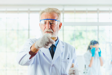 Portrait Science men working with chemicals in lab