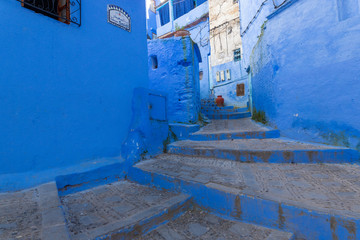 Deurstickers Street scene in the blue medina of Chefchaouen, Morocco