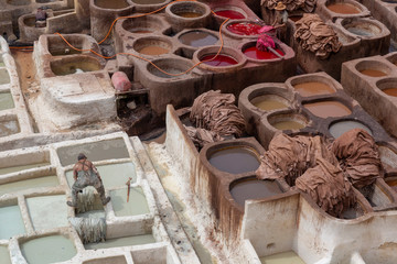 The traditional hand made Leather production in the old City in the historical Town of Fes in Morocco in north Africa. Morocco, Fes