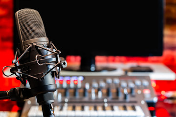 microphone on digital recording equipment in studio background