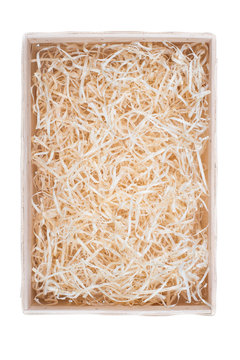 Top view of wooden box for eco gift filled with decorative shredded white paper. Isolated on white.