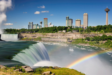 Niagara Falls with rainbow at summer morning. USA - Canada. Long exposure.