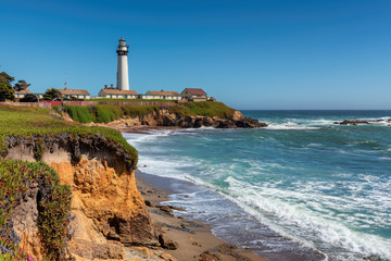 California beach with lighthouse. Pigeon Point Lighthouse in a sunny day. Pacific Ocean coastline, Pescadero, California